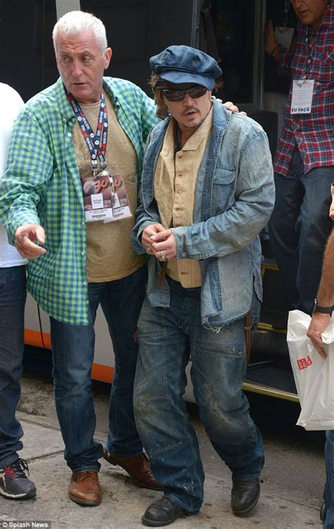 Johnny Depp dons double denim in Brazil with Hollywood