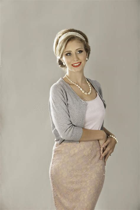 Happy 1950s Woman In Twinset And Pearls Stock Photo
