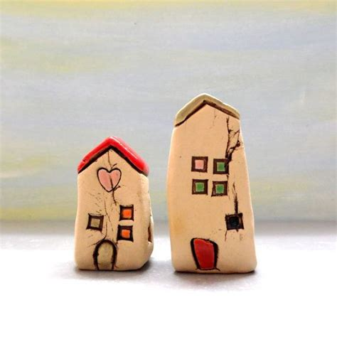 Little ceramic village of 5 houses with the word LOVE and