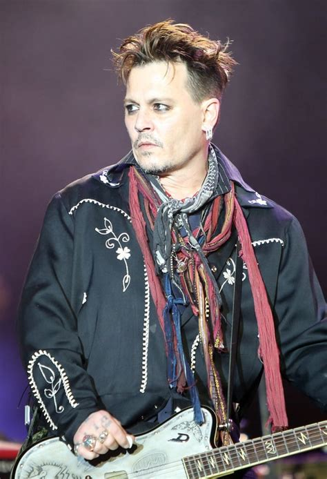 Johnny Depp Performs in Portugal After Amber Heard's
