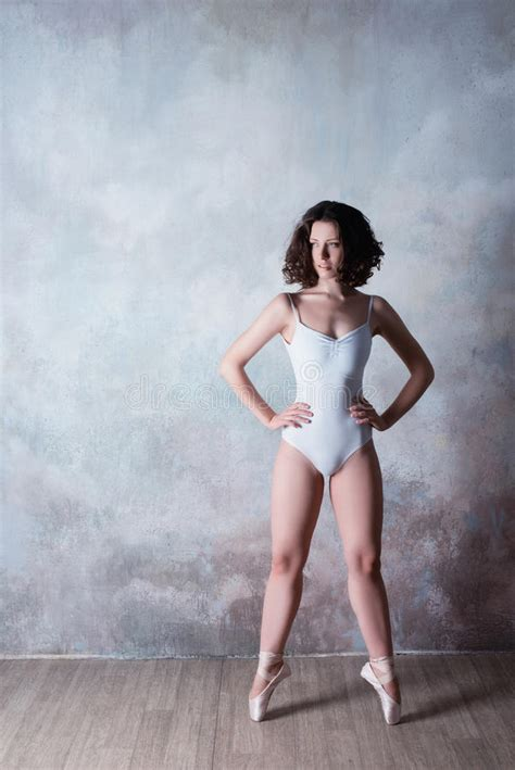 Ballerina In A White Bathing Suit With A Beautiful Body